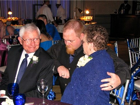 my parents and our son at his wedding